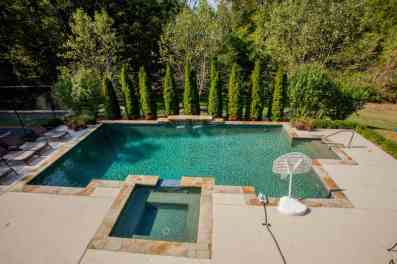 Gunite pool, hot tub, patio, deck & outdoor kitchen! WOW!