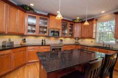 Granite center island & custom cabinetry