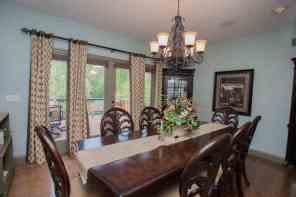 Formal dining room w/hardwood floor & access to deck for great indoor to outdoor flow!