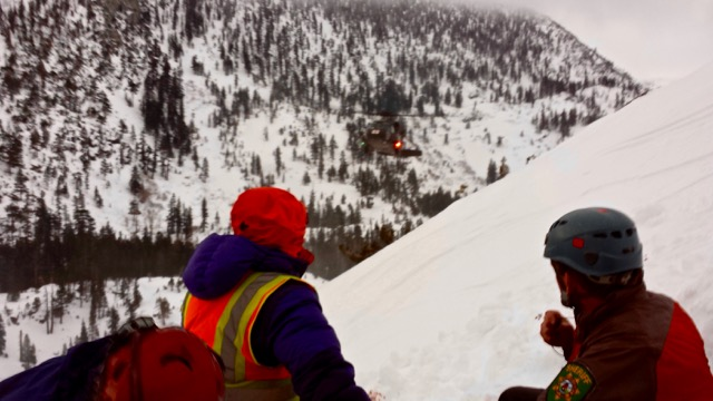 The helicopter arrives to transport a lost person from Maggies Peak in February. Photo/Provided