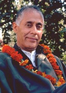 Swamiji with orange garland
