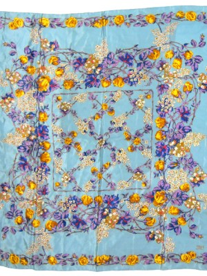 Liberty silk scarf with a light blue background and a vibrant floral design