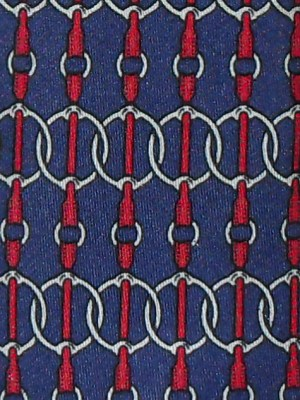 Equestrian horse tackle design silk tie on a blue background by Hermes
