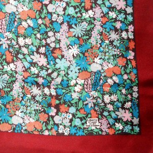 Liberty of London silk scarf with a bright floral design