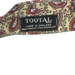 Vintage Tootal rayon cravat with a red and white paisley design on a yellow background