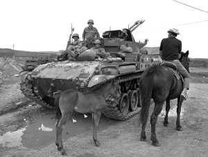 New Mexico National Guard troops searching for suspects in the 1967 Tierra Amarilla courthouse raid talk to a Canjilon resident on a northern New Mexico road (Ray Cary-Albuquerque Journal)