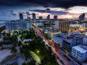 Aerial view of illuminated Ocean Drive and South beach, Miami, Florida, USA