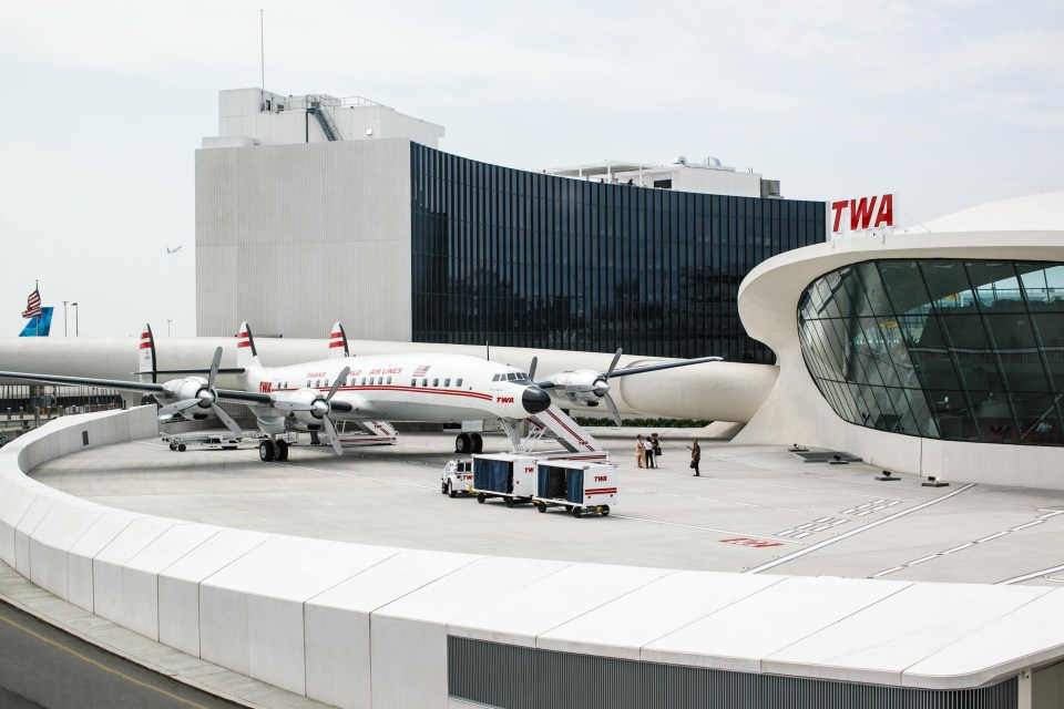 TWA Hotel exterior, with an original TWA plane that has been turned into a cocktail bar.