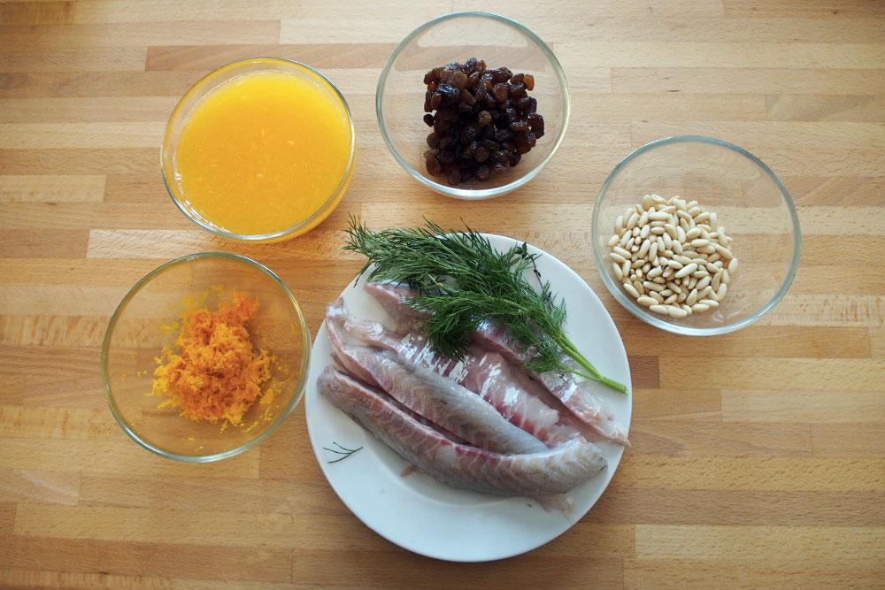 Involtini di branzino con uvetta, pinoli e arancia