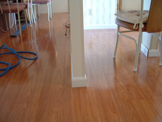 Vanier Laminate Photos  12mm Thick Beautiful Piano Finish Vanier laminate flooring installed around a wall photo