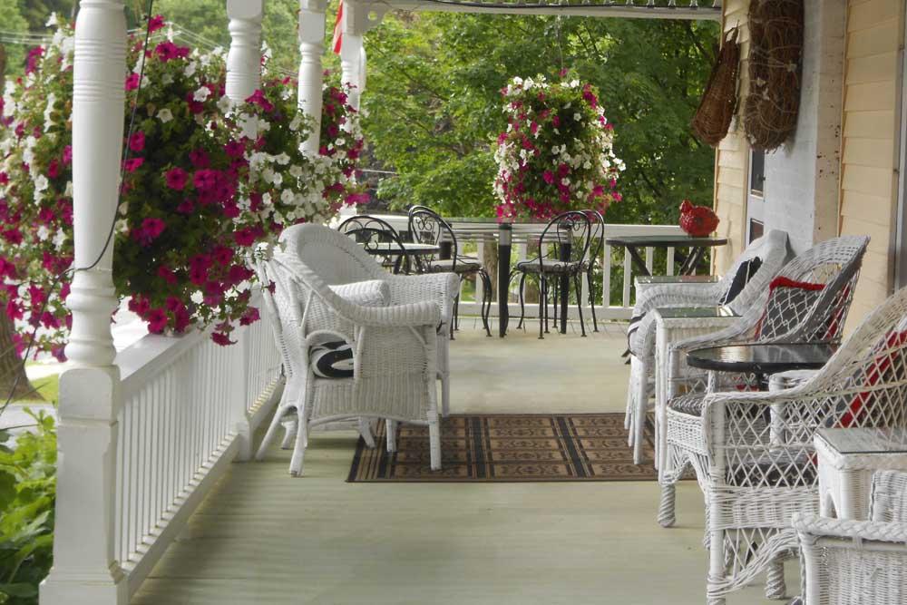 Wraparound porch with wicker chairs