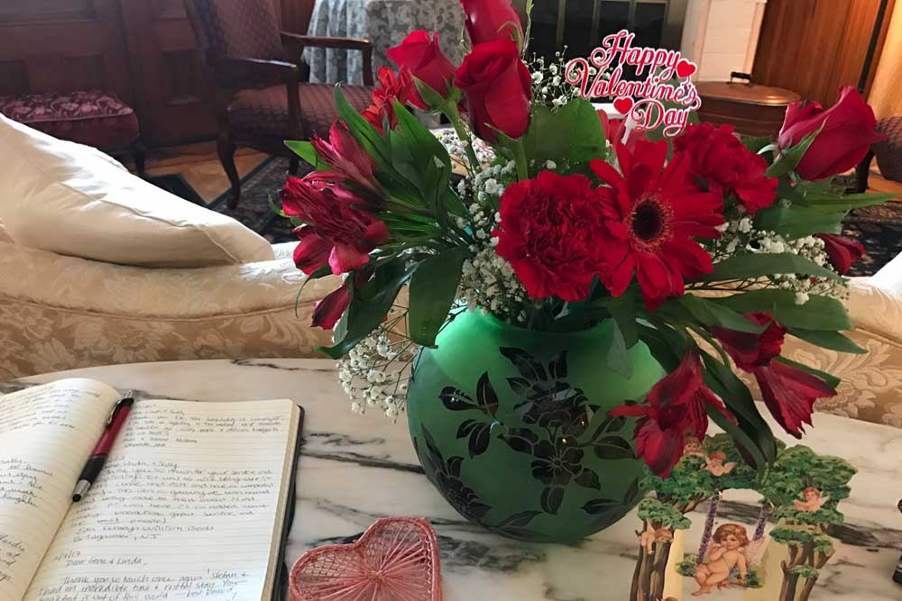 Close up of flowers and guest book