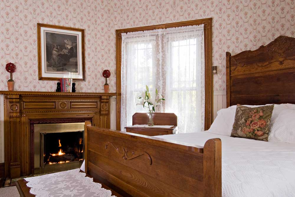 Wood Bed and Fireplace