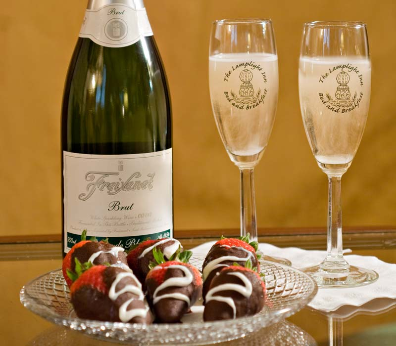 Chocolate covered strawberries and a bottle of champagne at Lamplight Inn Bed & Breakfast near Lake George