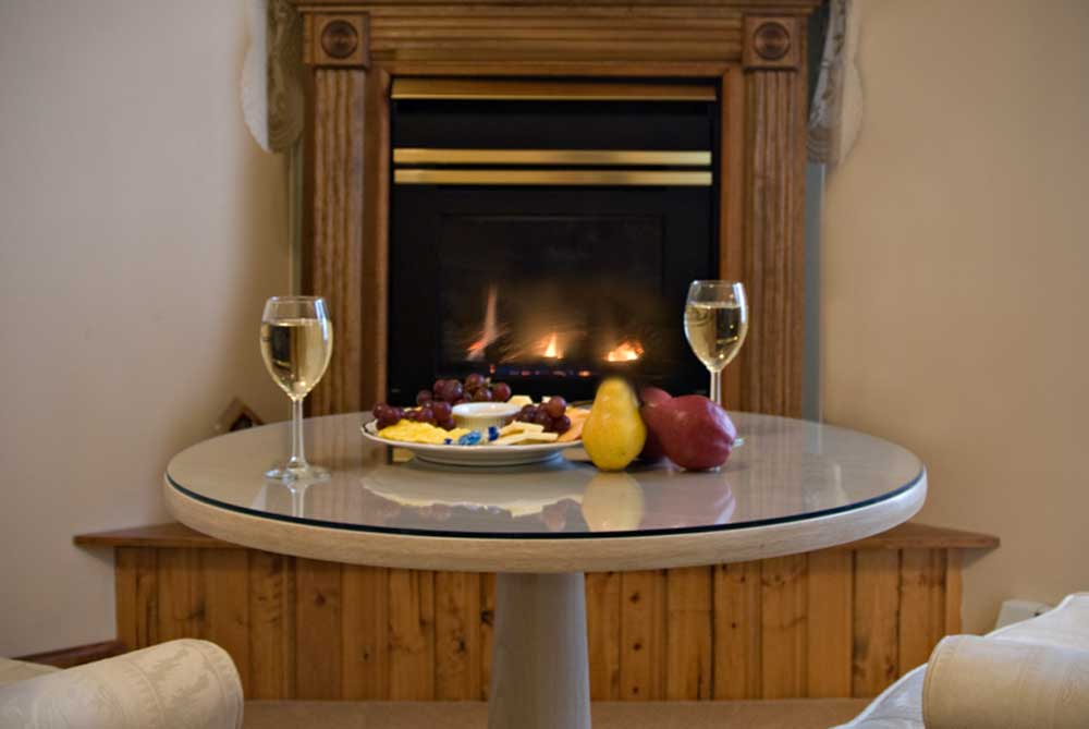 french mountain fire place with food and wine