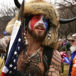 'QAnon Shaman' claims he stormed the Capitol 'at the request of the president'