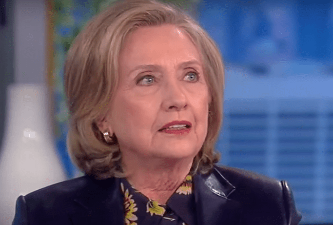 Hillary Clinton warns our democracy is still under attack by Trump and the GOP