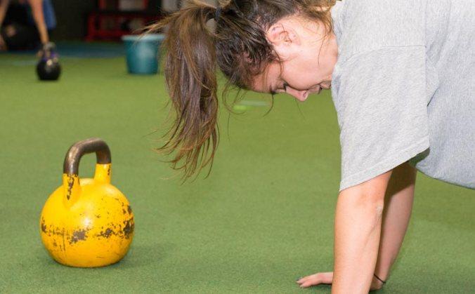 Kettlebells and push ups will make any girl sweat.