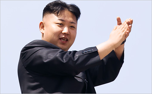 North Korean leader Kim Jong-Un (L) appl