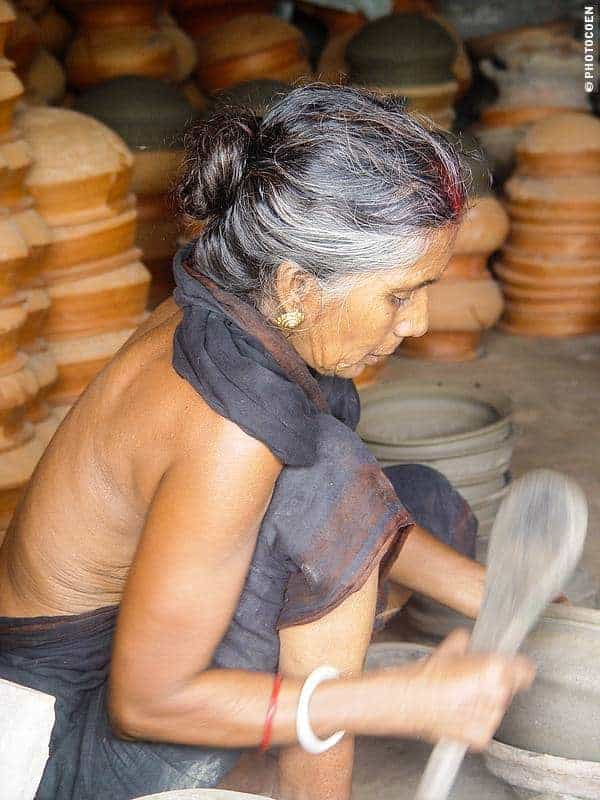 Woman Baking Pottery, Bangladesh (©photocoen)