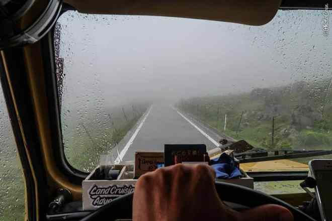 Typhoon in Japan: here looking through the windshield of the land cruiser out on an asphalted road but view obstructed by mist.