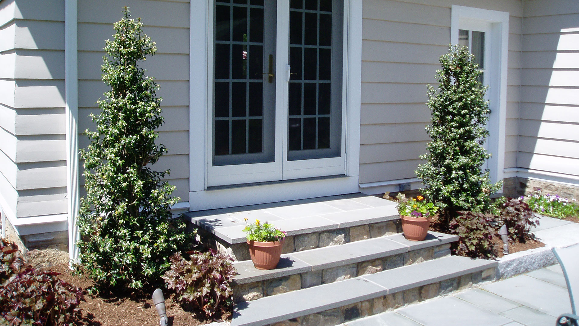 French Door with Curved Bluestone Steps