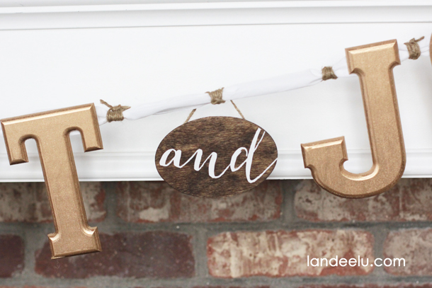 Gold Christmas Banner: Comfort and Joy | landeelu.com So easy to spray paint the letters gold and hot glue onto ribbon!