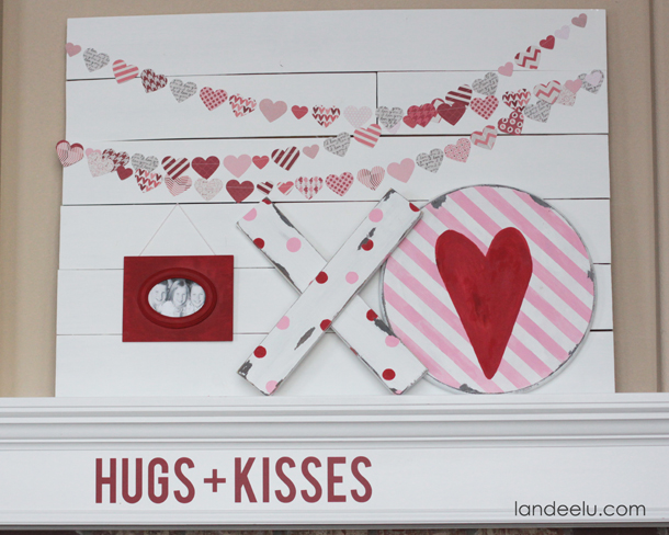 Valentine's Day Mantel: Hugs & Kisses | landeelu.com Love the DIY chippy XOs and heart garland!