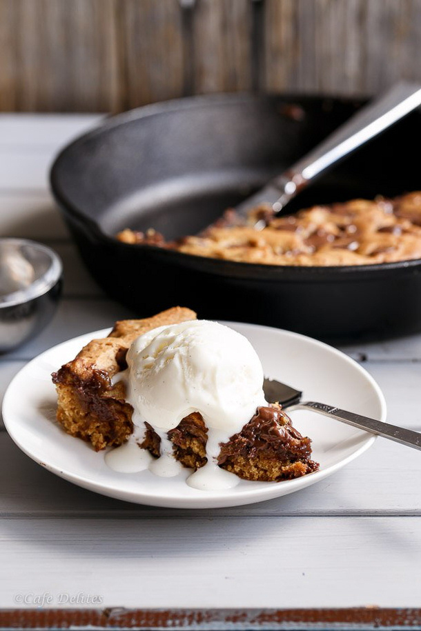 Nutella Stuffed Deep Dish Chocolate Chip Cookie Skillet Cookies Pizookie Recipe via Cafe Delites