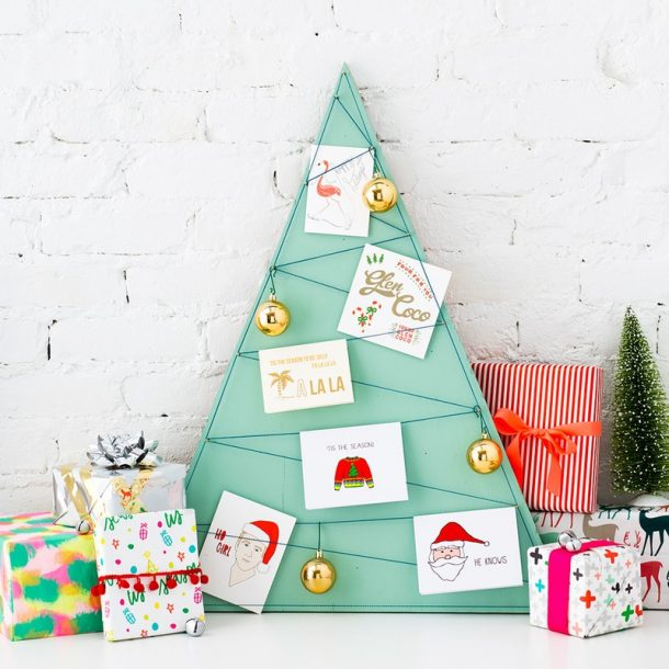 Darling and Easy DIY Wood and String Christmas Tree Card Display Tutorial | Brit + Co