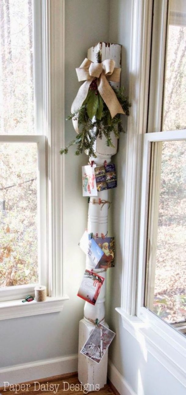"""Here's a fun """"farmhouse chic"""" idea! Display your Christmas cards on an old house column tied up with string! 