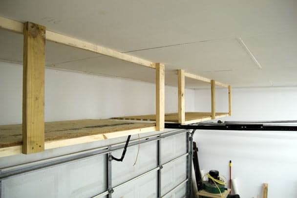 Budget friendly DIY shelving - add tons more storage above the garage door! | Jay's Custom Creations