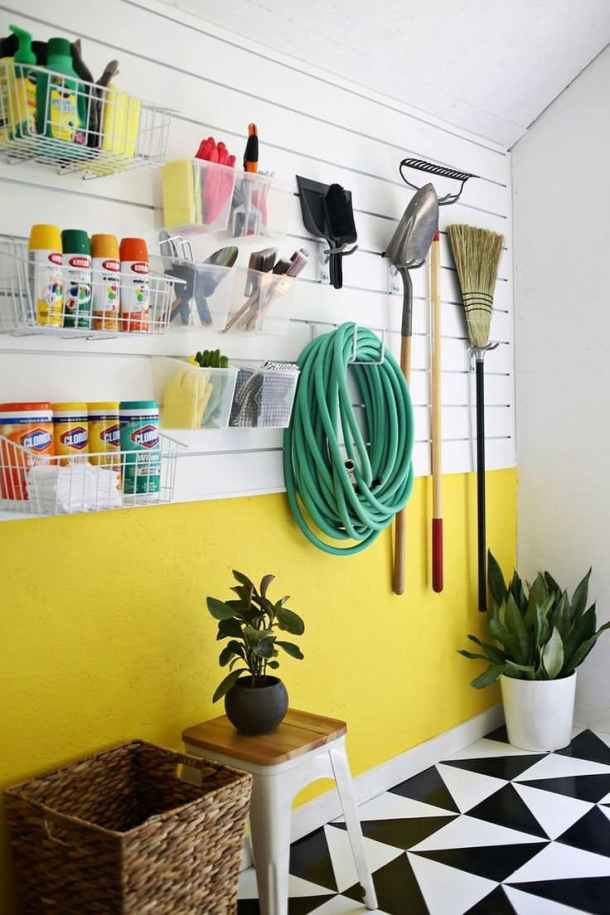 Isn't this slatwall system amazing! Love the variety of hooks and baskets you can incorporate into this one. via A Beautiful Mess