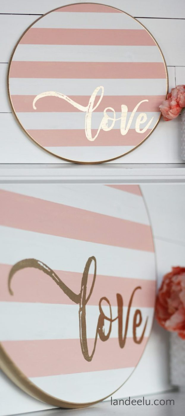 Grab a wood round from your local DIY store and make this darling striped Valentine's Day craft... a painted wood sign!