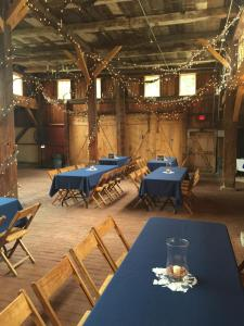 blue wedding decorations in Yellow Barn