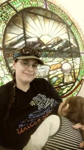 Breastfeeding in front of stained glass Ohio state seal at the Ohio Statehouse