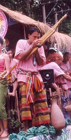 A Lao man playing the khene