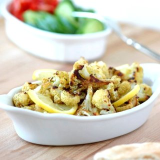An easy recipe for Roasted Spiced Cauliflower with cumin, pepper, and mint and finished with a squeeze of lemon. Use as a side or stuff into sandwiches.