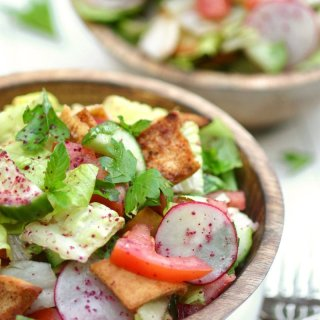 Think of Fattoush as the Middle Eastern version of the Italian panzanella salad--crisp veggies, fresh herbs, toasted pita bread, and a tangy sumac dressing.