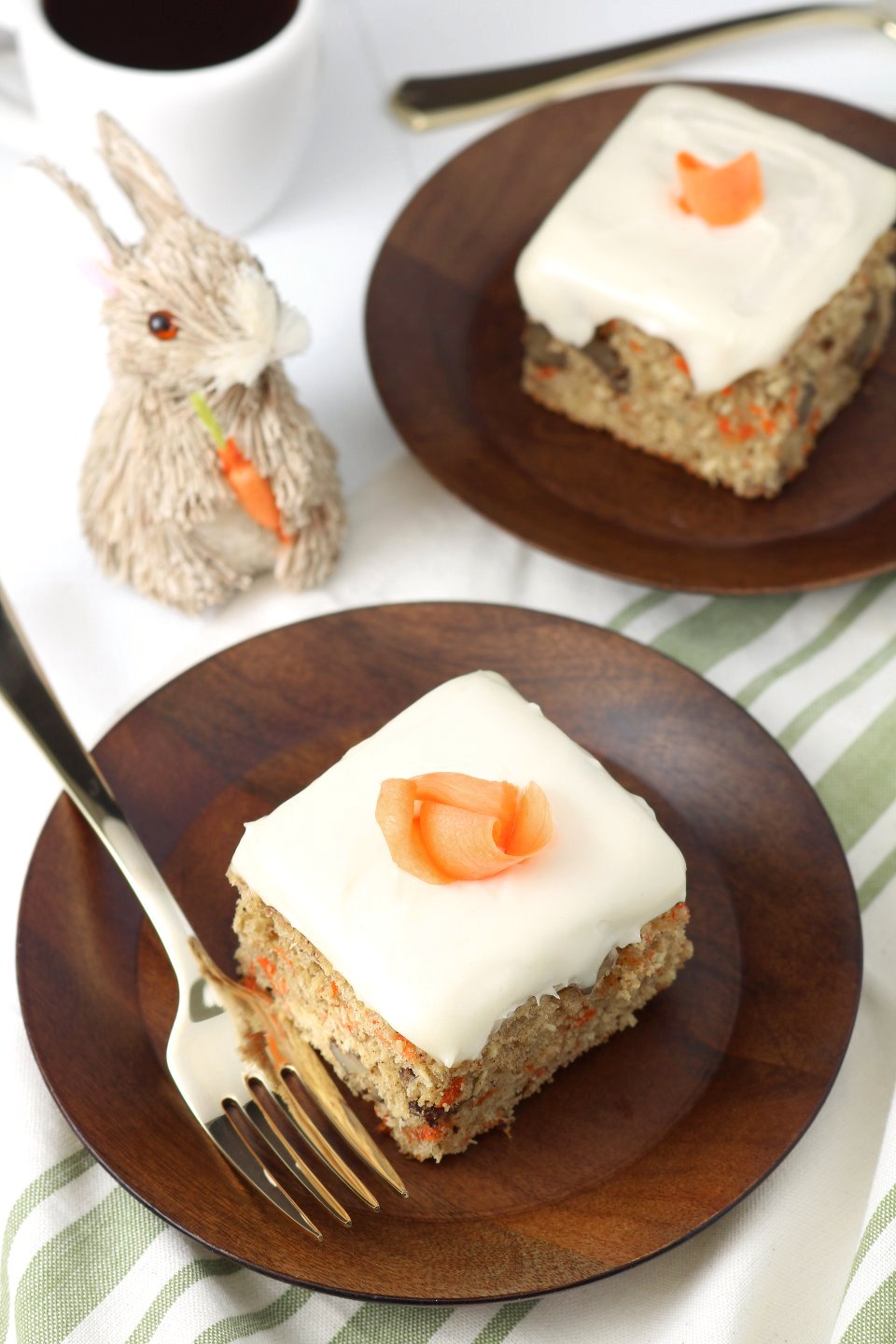 A versatile recipe featuring warm spices, coconut, and walnut to make this moist Vegan Carrot Cake with Cream Cheese Frosting irresistible.