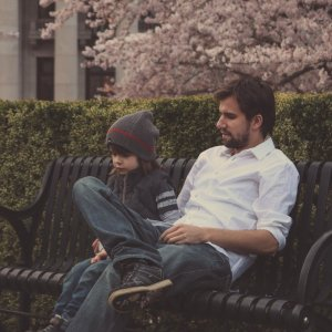 Man and Child on Park Bench