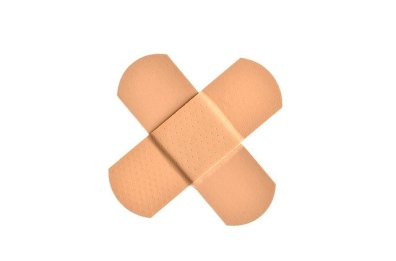Two tan bandaids overlapping in the form of an X