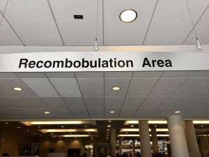 The Recombobulation Area is where airport passengers go to collect themselves after going through security. They gather their shoes, belts, electronics, and baggage before heading off to their flights and next part of their journey.