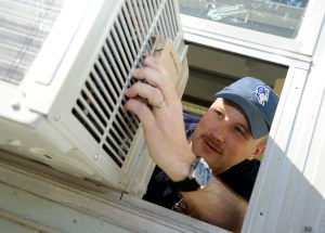 man looking at air conditioner