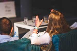 Spanish Interpreters - Woman speaking in meeting