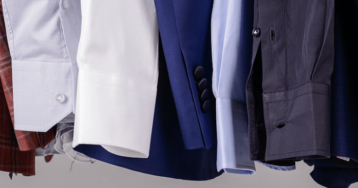 Close up on tailored dress shirts' cuffs, various colors