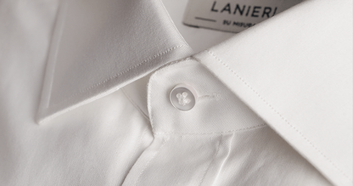 Close up on collar's button of a Lanieri's white shirt for men with cutaway collar