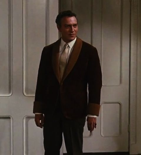 """Actor Christopher Plummer plays Captain Von Trapp in movie """"The Sound of Music"""" wearing a """"historical"""" version of the tuxedo."""