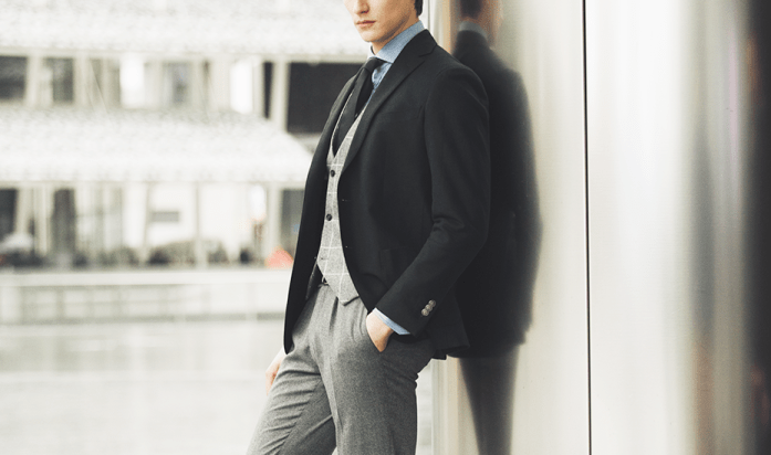 Spezzato: broken suit with black jacket and gray pants