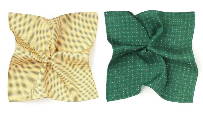 A yellow pocket square next to a green one